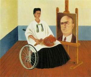 in this painting, frida is in her wheelchair, next to a portrait of Dr. Farill.  She is dressed in a white top and black long skirt and holds her paint brushes in one hand and her palette in the other.